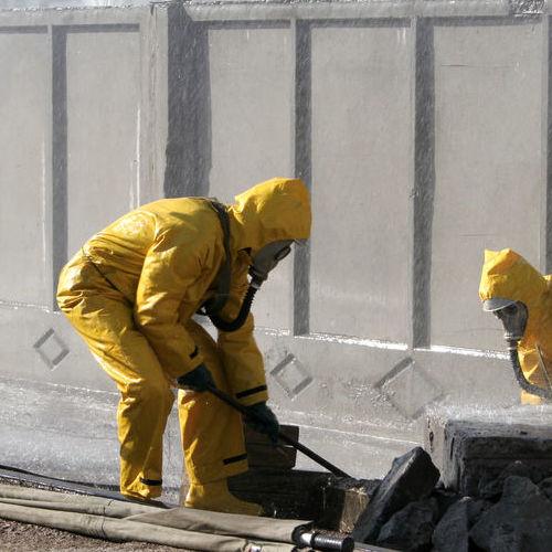 Technicians Clean Up Hazardous Materials.