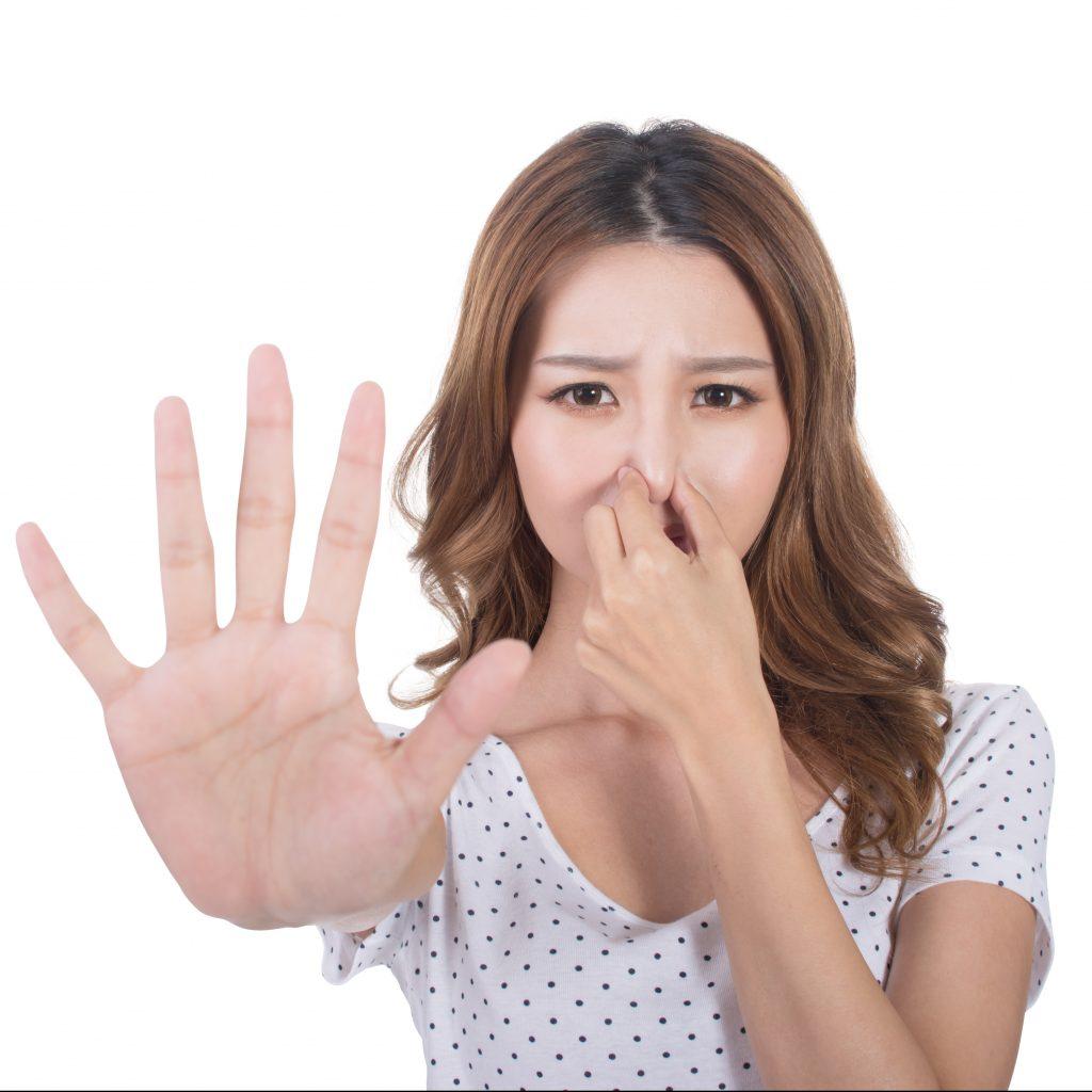 Girl Holding Her Nose